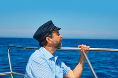 Beard sailor cap man sailing sea ocean in a boat Royalty Free Stock Photos