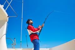 Beard sailor man fishing rod trolling in saltwater Royalty Free Stock Photos