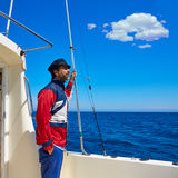Beard sailor man sailing sea in a boat captain cap Royalty Free Stock Photo