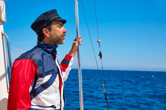 Beard sailor man sailing sea in a boat captain cap Stock Image