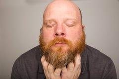 Beard scratching Royalty Free Stock Image