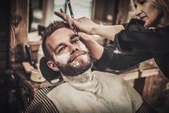 Beard shaving in barber shop Stock Photos