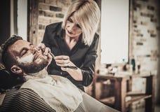 Beard shaving in barber shop Royalty Free Stock Photography
