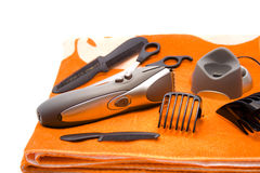 Beard tailor. And electric clippers Royalty Free Stock Image