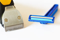 Beard trimmer against razor Stock Photography