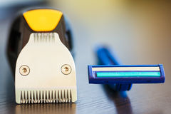 Beard trimmer against razor. Macro shot of beard trimmer against razor stock image