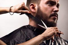 Beard trimming. Man Beard trimming studio shoot Royalty Free Stock Photos
