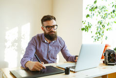 Beard young man working from home Royalty Free Stock Photo