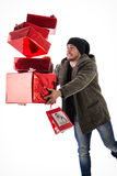 Bearded adult man dropping presents Royalty Free Stock Photography