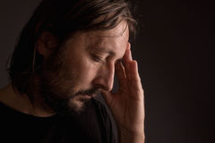 Bearded adult man with migraine headache Stock Photography