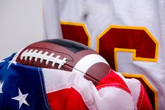 Bearded American football ball with national flag. stock photo
