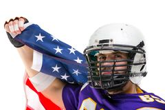 Bearded American football player with national flag, portrait. royalty free stock image