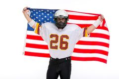 Bearded American football player with national flag, portrait. stock photography