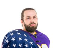 Bearded American football player with national flag, portrait. stock photos