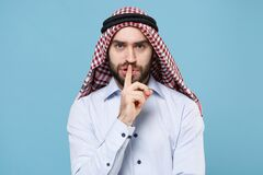 Bearded arabian muslim man in keffiyeh kafiya ring igal agal casual clothes  on pastel blue background. People