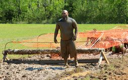 Bearded Asian Man Stares Down Obstacle Course during Annual Mud Run Royalty Free Stock Photography