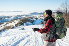 Bearded backpacker standing on the mountain royalty free stock image