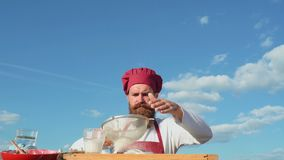 Bearded baker.Baker cooking outside. Eco bakery. Baker bake a fresh bread.  stock video footage