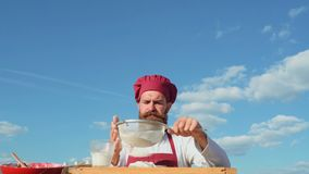 Bearded baker.Baker cooking outside. Eco bakery. Baker bake a fresh bread.  stock video