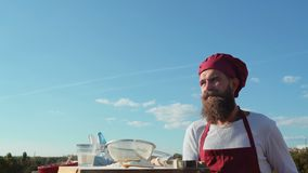 Bearded baker. Baker cooking outside. Eco bakery. Baker bake a fresh bread.  stock footage