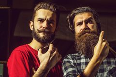 Bearded barber men with razor stock photos