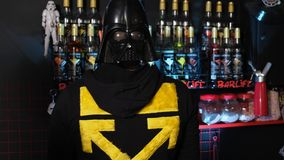 The bearded barman turns and shows the mask of Darth Vader on the back of his head. Kyiv, Ukraine - September, 2019: The bearded barman turns and shows the mask stock video