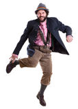 Bearded bavarian man dancing. Full body portrait of a middle-aged man in traditional, authentic bavarian dress while dancing a Schuhplattler Stock Images