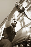 Bearded Biker Man Sitting on a Motorcycle Stock Photography