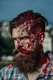 Bearded bloody zombie man Stock Photo