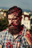 Bearded bloody zombie man Royalty Free Stock Photos