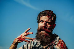 Bearded bloody zombie man Stock Photos