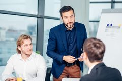 Boss leader coaching in office. On job training. Business and Education concept. Bearded boss leader coaching and teaching in modern office. On job training Stock Image