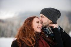 Bearded boyfriend kissing on his girlfriend`s forehead Stock Photo