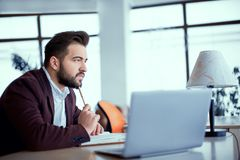 Thinking man in the office royalty free stock photos
