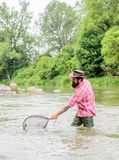 Bearded brutal fisher catching trout fish with net. If fish regularly you know how rewarding and soothing fishing is