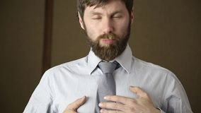 Bearded business executive man yawning on a next day after a party.  stock footage