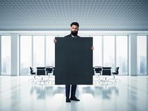 Bearded business man with blackboard at Royalty Free Stock Photography
