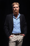 Bearded business man with hands in pockets Royalty Free Stock Photography