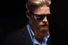 Bearded business man looks down Royalty Free Stock Images