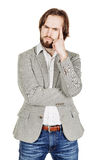 Bearded business man with suspicious emotion. human emotion expr Stock Image