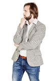 Bearded business man with suspicious emotion. human emotion expr Royalty Free Stock Photography