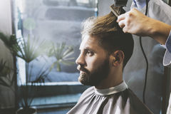 Bearded businessman in a barber shop stock photography