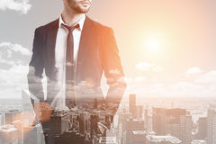 Bearded businessman and a city, toned Royalty Free Stock Photos