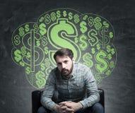 Bearded businessman and dollar signs on blackboard Royalty Free Stock Photos
