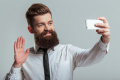 Bearded businessman with gadget royalty free stock photos