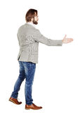 Bearded businessman giving hand for an handshake.  human emotion Royalty Free Stock Images