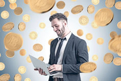Bearded businessman with laptop, coins royalty free stock photos