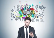 Bearded businessman looking at phone, brain, cogs Stock Photography