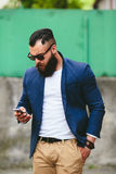 Bearded businessman looking at phone Royalty Free Stock Photo