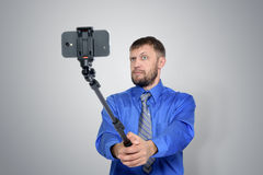 Bearded Businessman making selfie with a stick Royalty Free Stock Photo